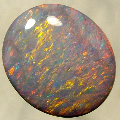 SOLID SEMI BLACK OPAL Large opal. Golden fire showing a crisp and bright even pattern. SEE VIDEO
