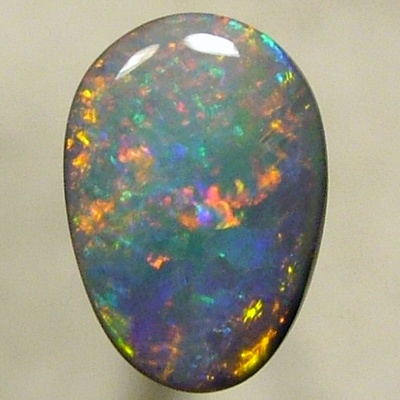 SOLID SEMI BLACK OPAL Sparkling red and green with a neon glitter of yellow gold