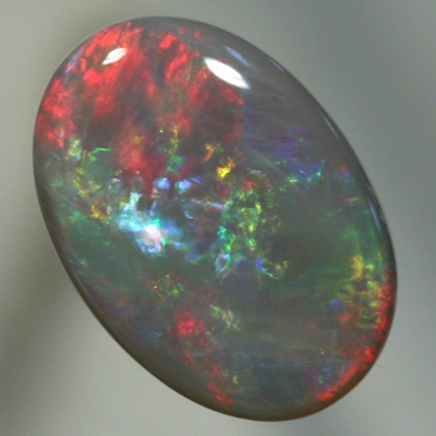 SOLID SEMI BLACK OPAL Rolling flashes of red, green and blue. SEE VIDEO