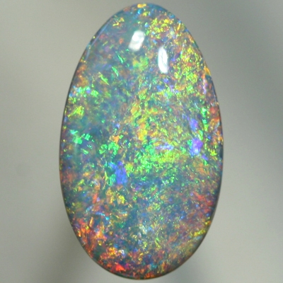 SOLID SEMI BLACK OPAL Sparkling Floral Harlequin pattern with orange and yellow over green and blue.  SEE VIDEO