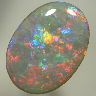 SOLID SEMI BLACK OPAL Large opal, red to blue to greens with a hint of gold. SEE VIDEO
