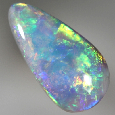 SOLID SEMI BLACK OPAL rolling flashes of bright fire. SEE VIDEO