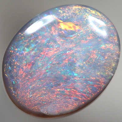 SOLID SEMI BLACK OPAL Bright red sparkles over blue. SEE VIDEO