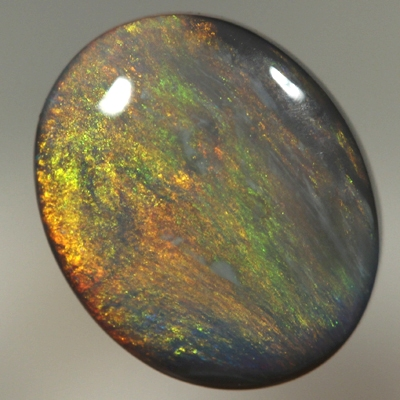SOLID BLACK OPAL Burning red throught orange and green
