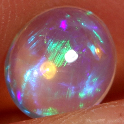 SOLID CRYSTAL OPAL Bright rolling flashes, transparent body.