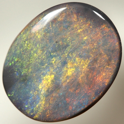 SOLID BLACK OPAL Large opal with burning red over ocean blue SEE VIDEO