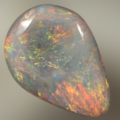 SOLID SEMI BLACK OPAL Glittery bright show of red, orange over blue sparkles