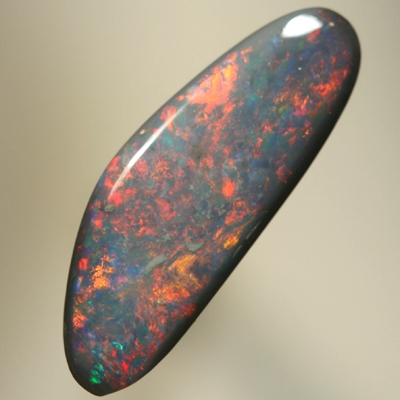 SOLID BLACK OPAL Bright, strong red fire over deep ocean blue. SEE VIDEO