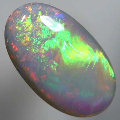 SOLID SEMI BLACK OPAL Crisp rolling flashes of green, orange and purple