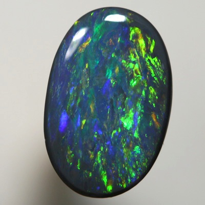 SOLID BLACK OPAL Strong gold copper fire. SEE VIDEO