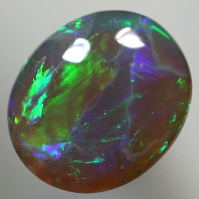 SOLID BLACK CRYSTAL OPAL Bright greens rolling flashes with orange and blue