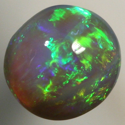 SOLID BLACK CRYSTAL OPAL Bright greens rolling flashes over a high dome
