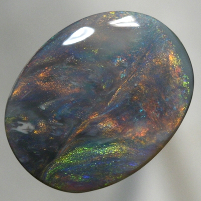 SOLID BLACK OPAL Large opal with moving orange, green and blue SEE VIDEO