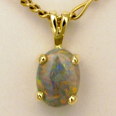 18k Yellow Gold Pendant with a SEMI BLACK SOLID OPAL Bright red and orange plays over green and purple