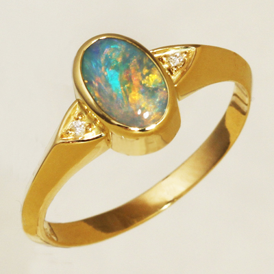 18k Yellow Gold Ring with two diamonds and a BLACK OPAL Sparkling bright orange and green over blue