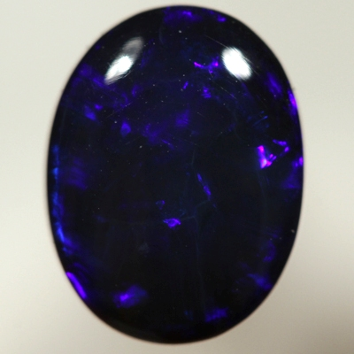 SOLID BLACK OPAL Royal blue rolling flashes. SEE VIDEO