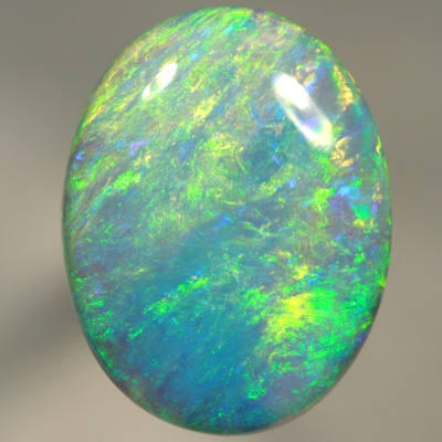 SOLID CRYSTAL OPAL Large opal. 11ct.  Bright green over purple. SEE VIDEO