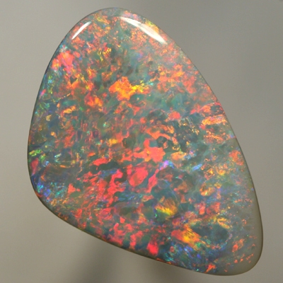 SOLID SEMI BLACK OPAL Sparkling red and orange play over blue. Top quality. SEE VIDEO