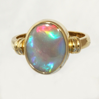 CUSTOM MADE 18k Yellow Gold Ring with a SOLID SEMI BLACK OPAL Large rolling flashes of bright red turning to peacock blue with a touch of green and purple