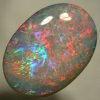 SOLID SEMI BLACK OPAL Colourful opal with red, green and blue mixed.  SEE VIDEO