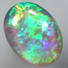 SOLID CRYSTAL OPAL Beautiful green rolling flashes over a soft purple hue