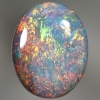SOLID SEMI BLACK OPAL Bright sparkling orange and green over blue. SEE VIDEO