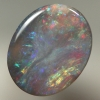 SOLID SEMI BLACK OPAL Sparkles of red, orange, green and blue