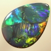 SOLID BLACK OPAL Flagstone Harlequin pattern, bright neon fire SEE VIDEO