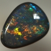 SOLID BLACK OPAL Golden fire, red, orange and yellow with blue