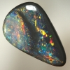 SOLID BLACK OPAL Pretty opal with sparkling multicolours between bands of black opal