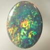 SOLID SEMI BLACK OPAL Rolling flashes of orange, green with touches of red and blue