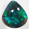 SOLID BLACK OPAL Turquoise and emerald green fire in rolling flashes