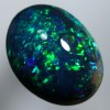 SOLID BLACK OPAL Bright green shades sparkle over a medium high dome