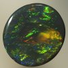 SOLID BLACK OPAL Golden copper on green, top quality. SEE VIDEO