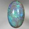SOLID BLACK CRYSTAL OPAL Swirls of bright colours