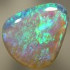 SOLID CRYSTAL OPAL Beautiful green and blues sparkle in a 3D pattern with a hue of purple through out