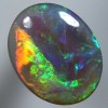 SOLID SEMI BLACK OPAL Rolling flashes of orange to green SEE VIDEO