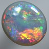 SOLID SEMI BLACK OPAL Clean, bright rolling flashes in a Rainbow Flame pattern