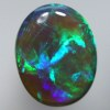 SOLID BLACK CRYSTAL OPAL Bright green, turquoise and blue in rolling flashes