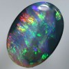 SOLID BLACK CRYSTAL OPAL Bright fire of red to green and a beautiful blue