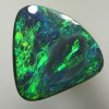 SOLID BLACK OPAL Bursting with green fire in all shades. SEE VIDEO