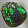 SOLID BLACK OPAL Pretty! Sparkling and bright gemmy green fire. SEE VIDEO