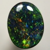 SOLID BLACK OPAL Mystical fire, red, purple and green explodes in a Pinfire pattern. SEE VIDEO