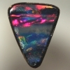 SOLID BOULDER OPAL Bright cherry red, magenta and blue surround black opal bands