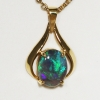 18k Yellow Gold Pendant with a SOLID BLACK OPAL Electric blue and green in the brightest rolling flashes